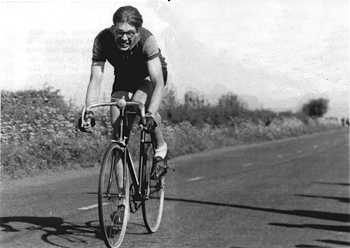 The image shows Ray at speed on one of his Raleighs but this time on fixed-wheel.