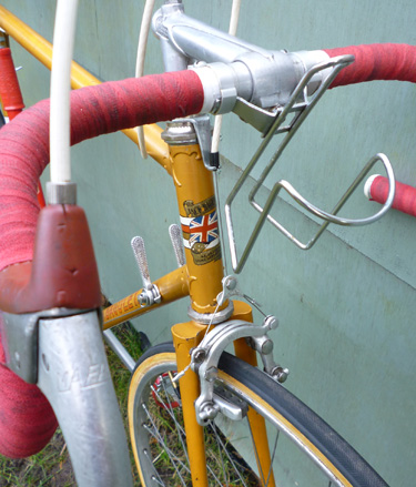 Close-up showing Mafac Racer brakes, GB bars and stem and 1960s bottle cage