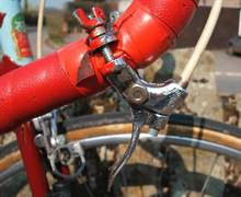 Cunning use of motor-cycle valve lifter as quick release brake lever for track/road use