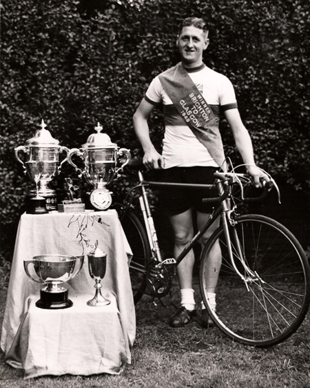Derek Browne contributes this image of Geoff Clark, wearing the sash as winner of the Brighton to Glasgow Race, 1948 Showing his P.T. (Percy) Stallard race bike and, interestingly, Allez pedals and Alp brakes, also note alloy G.B. wing nuts