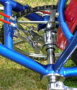 Detail shot of the bottom bracket clearly showing the sliding axle plus cable controls to move the chainwheel side-to-side to keep the chain in line when a gear change is made with the rear changer
