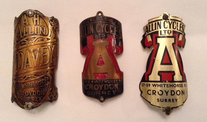 Three of Glenn's badges
