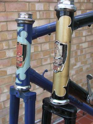 A pair of typical Holmes frames showing headbadges and lugs