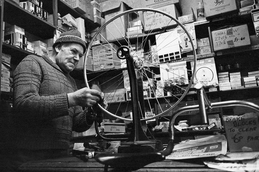 H R M wheelbuilding in his workshop at rear of the shop
