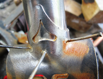 This and Right image:Bottom bracket brazed with pins in situ. Nails on the outside will be cut and ground flush with the lug