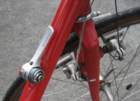 Time trial gear lever mount on top of down tube. Boss front and rear of fork for dual brakes.