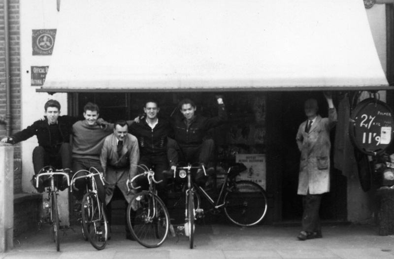 John Cooper outside the shop in 1955 with a bunch of happy looking customers, father Jack is in the doorway. Both Brian and John's sister Margaret remember the 'lads' taking out the veteran cycles from the collection for a spin