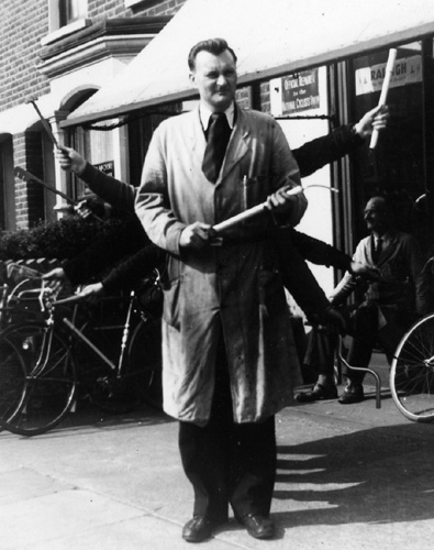 Another shot of John outside the shop - still larking about while Jack smiles in the background.Both of the images submitted by Brian Sandilands who was a regular customer at the shop. The photographs had been sent to a friend serving with the RAF in Aden to remind him of the good times at home