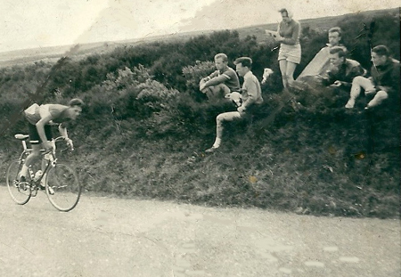Frank in Wally Green kit chasing the peleton after a puncture' cheered on by members of the Wembley Road Club