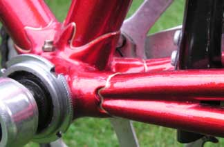 Center, left and right: Detail shots of dual chainstay intersections with bottom bracket and rear end