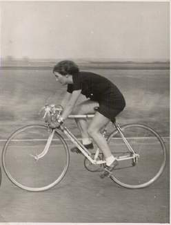 "Nina Beynon from Cambridge Section, looking stylish on her 1949 Claud Butler, at the finish of the 1951 National Championship 50-mile Time Trial. Nina has the original invoice from 1949 showing the frame number to be 9103847. It describes the machine as '21"" Inter Club Complete Cycle Mod.13 to Brevit Club design'. The finish is described as 'Off White E/D.B. lines with Chequered band on seat tube'. The price with 20% discount deducted was £28 4s 3d. My guess is that the E/DB relates to enamel finish decorated with double-box lining. Nina would love to re-acquire this frame so if you have it tucked away at the back of your shed you could be her hero."