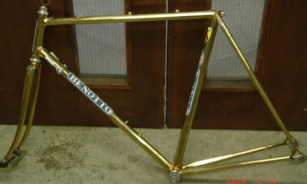 Fframe in its original livery of gold laquer over chrome