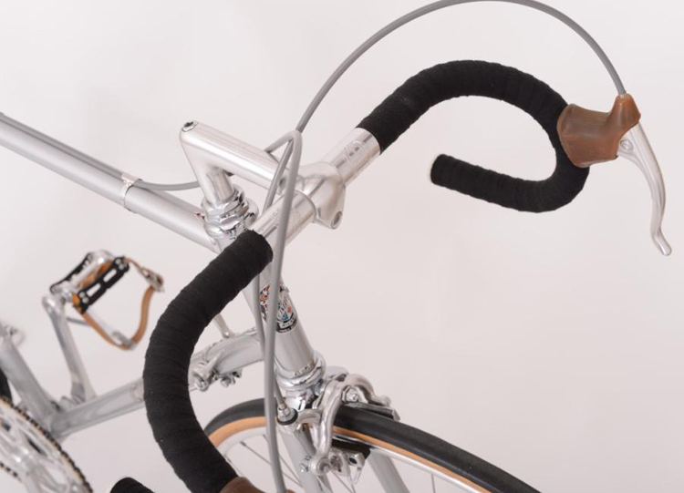 Campagnolo Record 'long reach' brake levers, early logo Cinelli Model 64 Giro D'Italia bars with triple clamp rings and Cinelli 1A 'Milano' stem with recessed bar clamp bolt introduced in 1972.