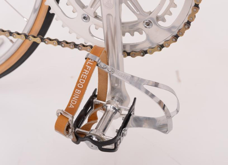 Campagnolo SL pedals with early version pointed cage, Alfredo Binda straps with brass clasp rollers and Christophe 'Speciale' toeclips – each clip size has different logo design