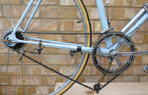 Drive chain as listed above - braze-on boss for tension arm under bottom bracket gives longer arm in effect, a feature favoured by many riders of the time
