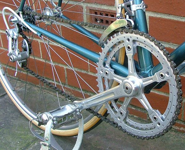 Drilled front derailleur clamp and chainrings