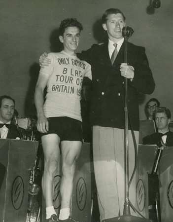 After the finish of Stage 5 - Aberystwyth to Blackpool won by Ken, here at the awards ceremony in the Wintergardens being congratulated by James (Oscar) Saville - now Sir Jimmy Saville