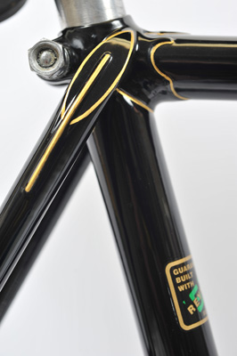 Lugwork detail at seat cluster, head and fork crown emphasised with very good gold lining on black