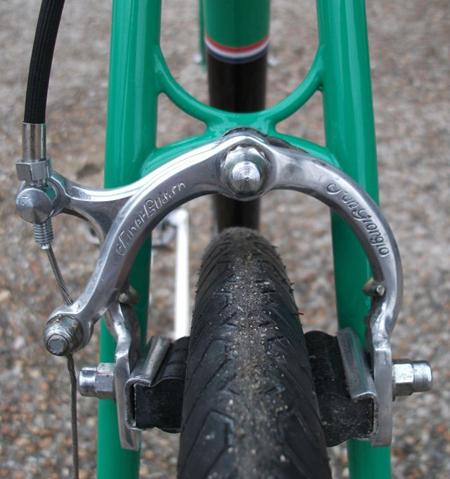 Sculptured brake bridge on seat stays