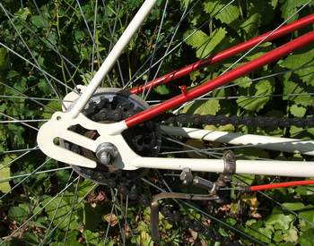 Rear end showing dual position with forward position for Osgear to allow wheel removal without the sprockets going forward to hit the gear change fork