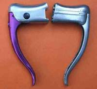 Two types of Arret levers The later, which appeared in 1959 has a blue GB logo, this one also has the anodised lever which is rare. There are also some anodised stirrups