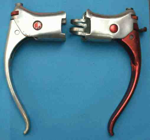 Super Hood levers. Left introduced 1953 with cable adjuster in the hood rather than as previously, seperate which sat in the cable exit on top of hood. Some of these were anodised Right: The later, called the Rapide (1959), has a horrible plastic Q/R which always snaps.
