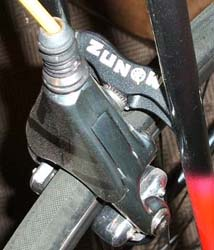 Zunow brake bridge on seat stays 'Just look at the dust on that brake'