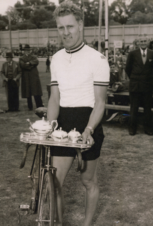Who's for a nice cup of tea! Pete Brotherton proudly displaying his trophy for winning the 'Bendigo Golden Mile' , Australia -1957