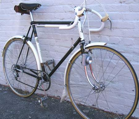 """This machine was custom-ordered for the original owner by his father who worked for Raleigh, Nottingham, for over 40 years. He rode it regularly but in the early 1960s changed out the original components to GB """"66"""" brakes, GB Hiduminium stem, Huret Allvit derailleur, Weinmann alloy 27"""" clincher rims on Normandy large flange hubs etc. Not used since the mid 1980s. Purchased on eBay (UK) on 21 November 2006. All other non original parts replaced with correct components as per catalogue specification except for stem and 'bars. Back on the road 27 January 2007."""
