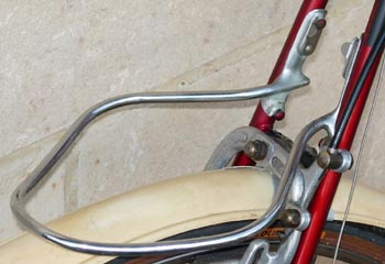 Custom-made carrier for the RRA engages on bosses inside seat stay