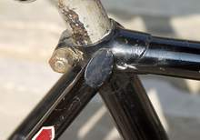 This is seat lug and seatstay top from a 1920s Bastide; earlier Bastides used a plainer cap sometimes with a forward facing seat bolt.
