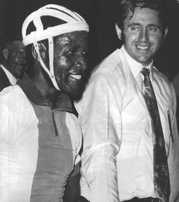 Pefeni Mtembu of Libanon gold mine being congratulated by Basil Cohen after winning a bronze medal in the 1973 South African Games.