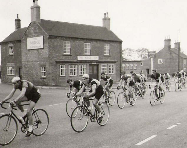 Road race in the 1950's going past the Midge Inn near Hatton in Lincolnshire