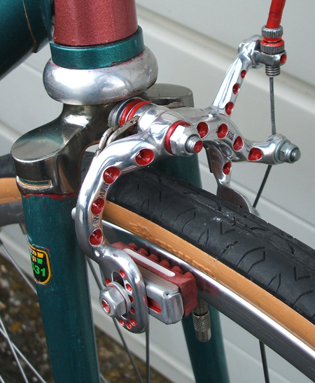 Brake stirrup with block routed and painted