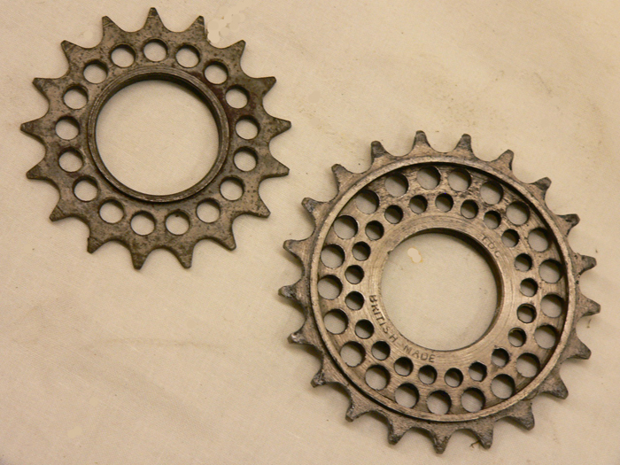 The 17T top-left with a single line of drilling whereas the 21T TDC sprocket has ample room for double drilling. The above are owned by Alex Von Tutschek who tells us that Ray Booty drilled the sprocket on his sub-four-hour 100-mile time trial machine and then had it annealed and re-hardened at his place of work.