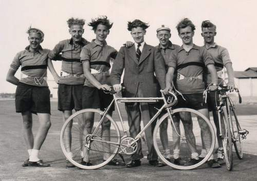 Members of the club, after a race at RAF Devesoir. (I am second from the right) Either a very windy day or a really scary photographer