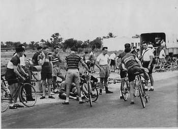 This is a typical Sunday morning scene preparing for the start of a '25' on the Canal Road. It was outside our camp - see the kilo stone