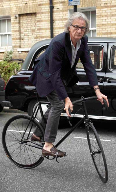 Sir Paul Smith - world renowned fashion designer who undertakes other design projects, including one with Mercian Cycles at Derby, seen here track standing on his 'stealth' Mercian track machine finished in matt black and devoid of any transfers or badges apart from 'Paul Smith' engraved topeyes. (Image Horst Friedrichs)