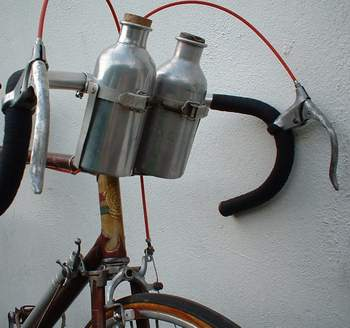 Paget alloy bottle cages with spring loaded clip, alloy bottles and cork stoppers. Also front lever with 'de-tensioner' ratchet