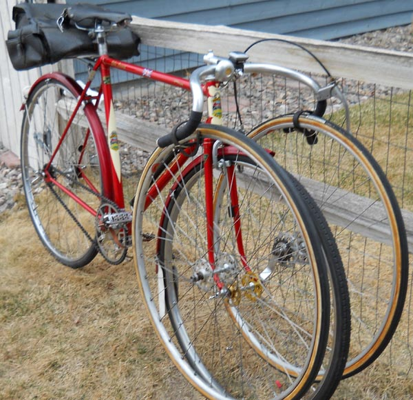 John's Mercian fitted with sprints as done in the 50's. Sprint wheels on alloy carriers with extra strap for security. On arriving at race event the saddlebag and mudguards came off and the sprints replaced the 'pressures'. After the event the procedure was reversed and the set-up was often ridden for an extra hundred miles or so on a club run.