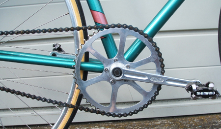 Stronglight 49 5-pin alloy cranks with TA 49T alloy ring and Shimano SPD pedals There is only one position on the 5 bolts which will give equal spacing of the arms either side of cranks Check this before installing and tightening all the bolts - been there, done that!