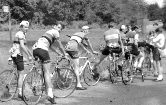 """This photo is of Ken """"Spike"""" Jacobs with cap and Trevor Cunnington both in Metro jerseys at the back of the field at the start of a race probably somewhere in Kent."""