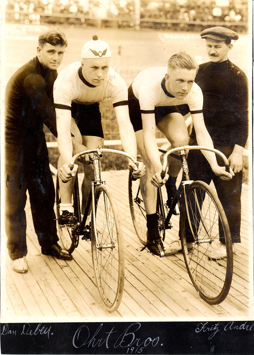 Ohrt brothers 1915 Left to right: Dan Debey, Hans Ohrt (Pierce track bike), Ernie Ohrt (Bastide track bike) and Fritz Andre (Hans Ohrt is wearing the 'Flying O' badge of the Olympic Club) Click on image for larger version showing great cycle detail