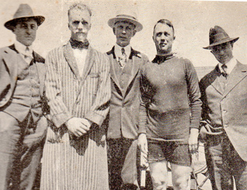 Who's Who at the San Francisco Velodrome L to R - Bob Diefenbacher, Hans Ohrt; pros. Ernest Ohrt, manager; Iver Lawson; Tommy Morgon. The Ohrt brothers were involved in the administration of the velodrome until they resigned due to a dispute over their dissatisfaction with the lack of visionary promotion. Hans Ohrt in dressing gown which was preferred trackside attire for racers both sides of the Atlantic.