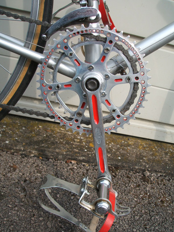 Stronglight cranks now highlighted in red with drilled and milled TA chainring
