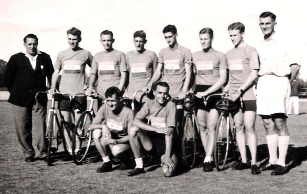 The eight members of the South African team with officials