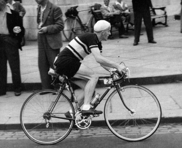 Peter Southart at speed on a Pennine, notice braze-on at top (rear) of seat tube. This braze-on takes a clip for the Pennine CO2 pump.