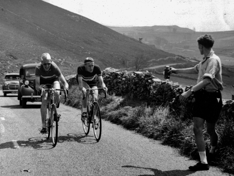 Charlie Mather, right, ready for a feed from his team in the Buxton Road Race 1957 (Hitter Hill, Debyshire), G Barlow, Stone Wheelers is the other rider.