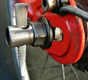 Figure 5 In the event of a cable or toggle chain breakage the four speed hubs will spring into high gear, which may not be ideal. The hub may be locked in second gear simply by placing the wedge through the left side axle nut, holding the indicator rod flush with the end of the axle.