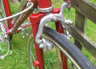 Front end showing lamp boss and mudguard clearance on this frame with track-ends , also shape of Strata brake stirrup